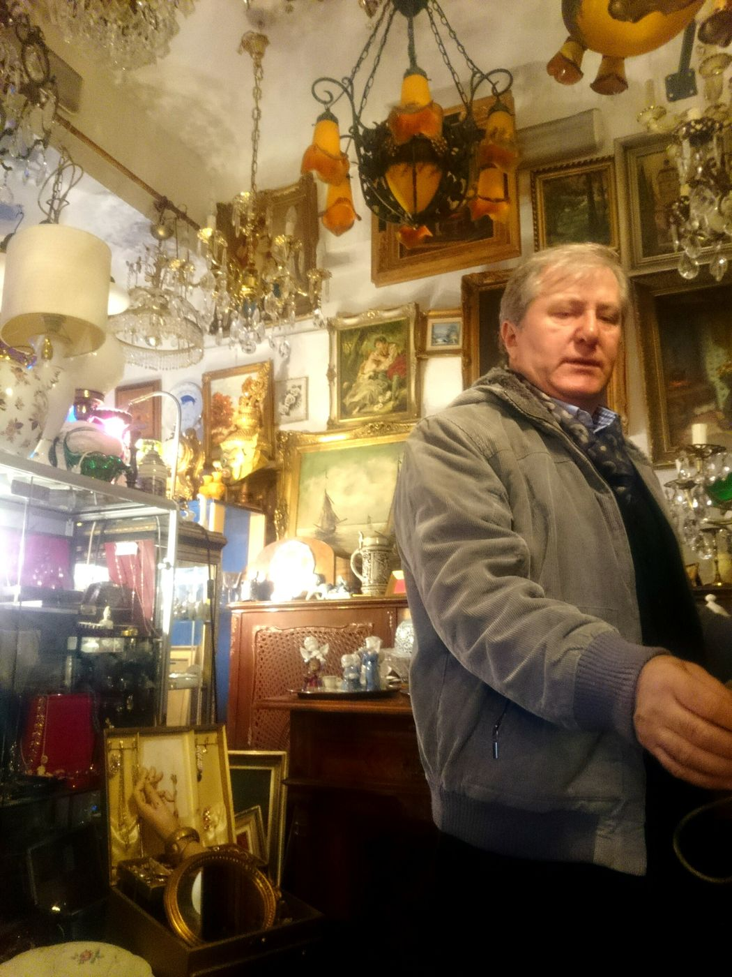 Shopkeeper Senior Adult One Man Only Gray Hair Indoors  Antique Shop Store Scenerie Statues Shiny Shop Golden Things Paintings Portrait Streetphotography