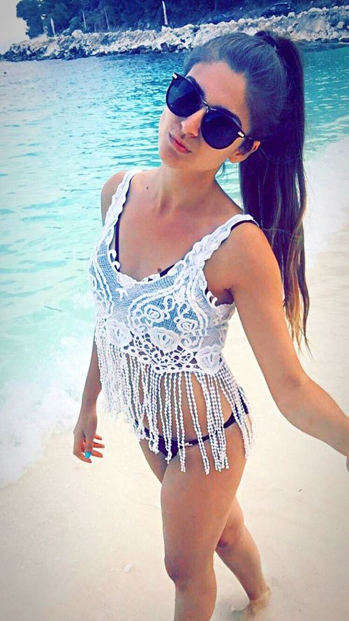Marble Beach Sunglasses Beach Bikini Summer Water Sea Young Adult Vacations Young Women Beauty Standing Lifestyles Leisure Activity Beautiful Woman Happiness Real People Portrait Beautiful People One Person Sand Thassos Island