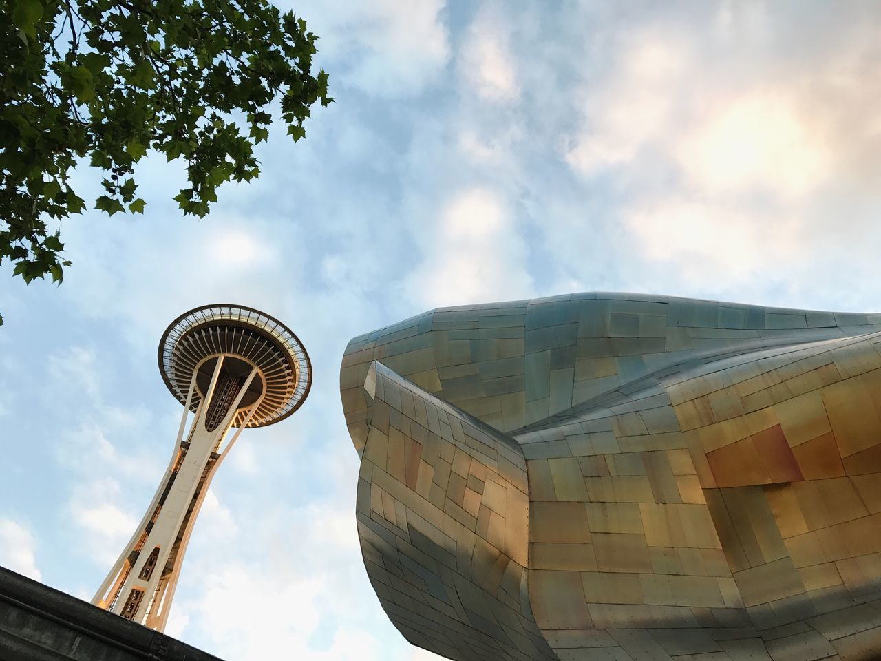 The Architect - 2017 EyeEm Awards Architecture Sky Built Structure Low Angle View Cloud - Sky Tower Building Exterior Day Travel Travel Destinations No People City Outdoors Modern Nature Radar Cityscape MoPop Seattle Frank Gehry Space Needle