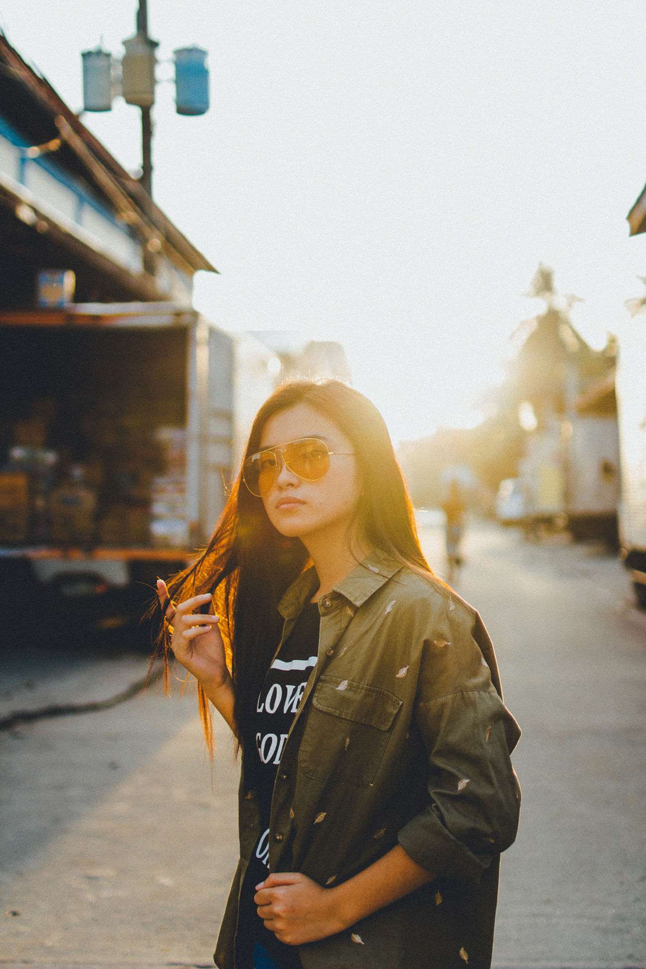 EyeEm Best Edits EyeEm Best Shots Eyeem Philippines Golden Hour Long Hair Outdoors Portrait Real People Street Sunlight Sunset Woman Woman Portrait Women The Portraitist - 2017 EyeEm Awards