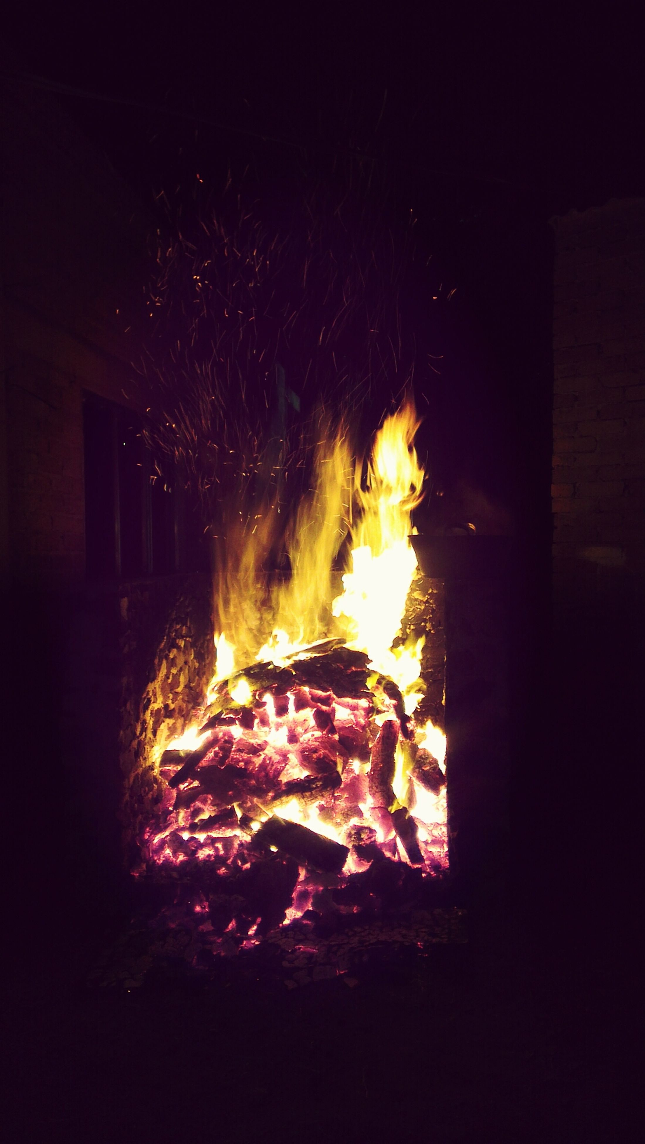 night, illuminated, burning, fire - natural phenomenon, flame, glowing, heat - temperature, dark, fire, light - natural phenomenon, long exposure, motion, bonfire, firewood, built structure, no people, orange color, outdoors, building exterior