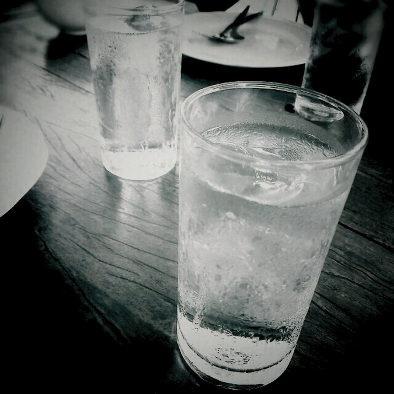 drink, food and drink, drinking glass, table, refreshment, indoors, freshness, still life, glass - material, close-up, alcohol, drinking straw, glass, healthy eating, transparent, high angle view, cocktail, focus on foreground, ice cube, cold temperature