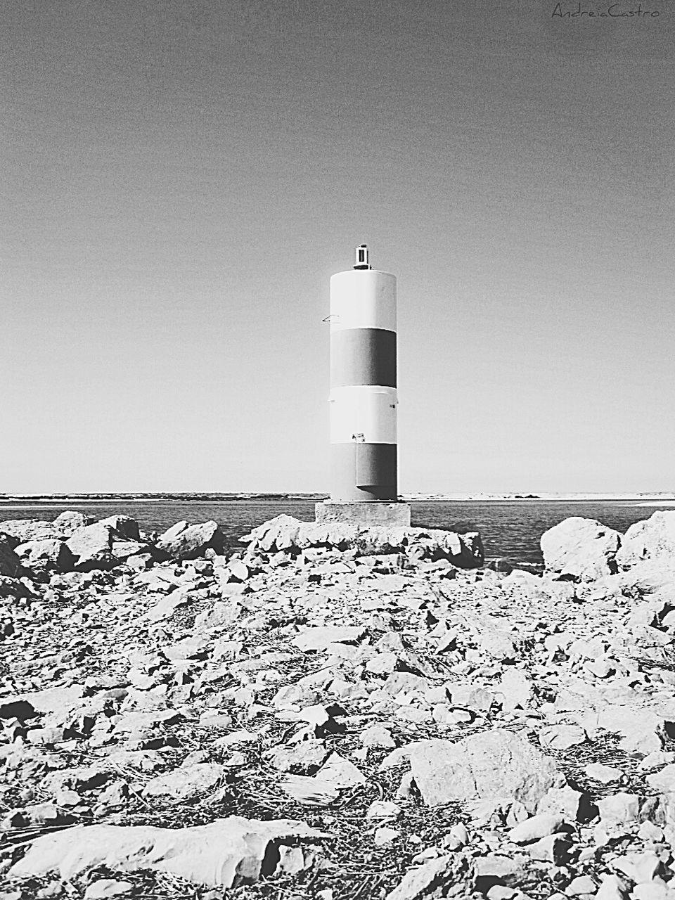 lighthouse, guidance, clear sky, built structure, beach, day, sea, copy space, direction, safety, sand, no people, horizon over water, outdoors, building exterior, architecture, nature, sky, sand dune