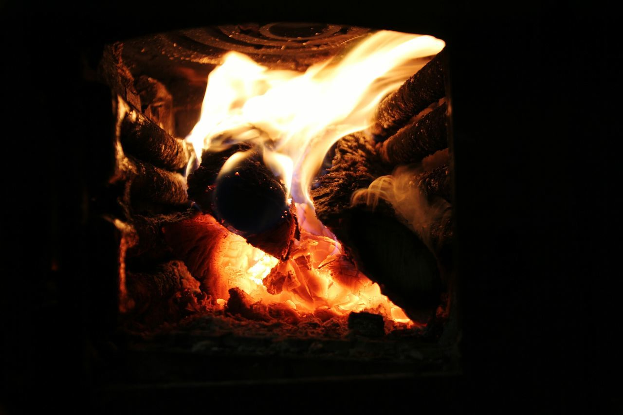 Heat - Temperature Flame Burning No People Indoors  Close-up Molten Night Illuminated Fire Indoors  Foundry Metal Industry Day Flames And Wood Stove Warm Cold Days Winter House Yellow Orange Black Felling Alive