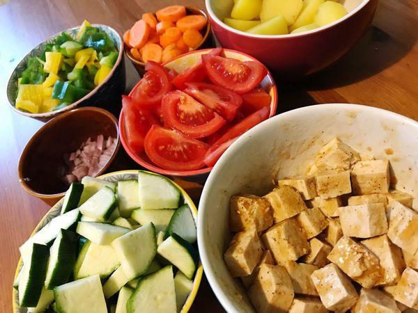 Cooking Preparing Food Zucchini Tomato Vegetarian Food Tofu Bowl Food And Drink Food Vegetable Freshness Healthy Eating Variation Indoors  Table SLICE No People Preparation  Chopped