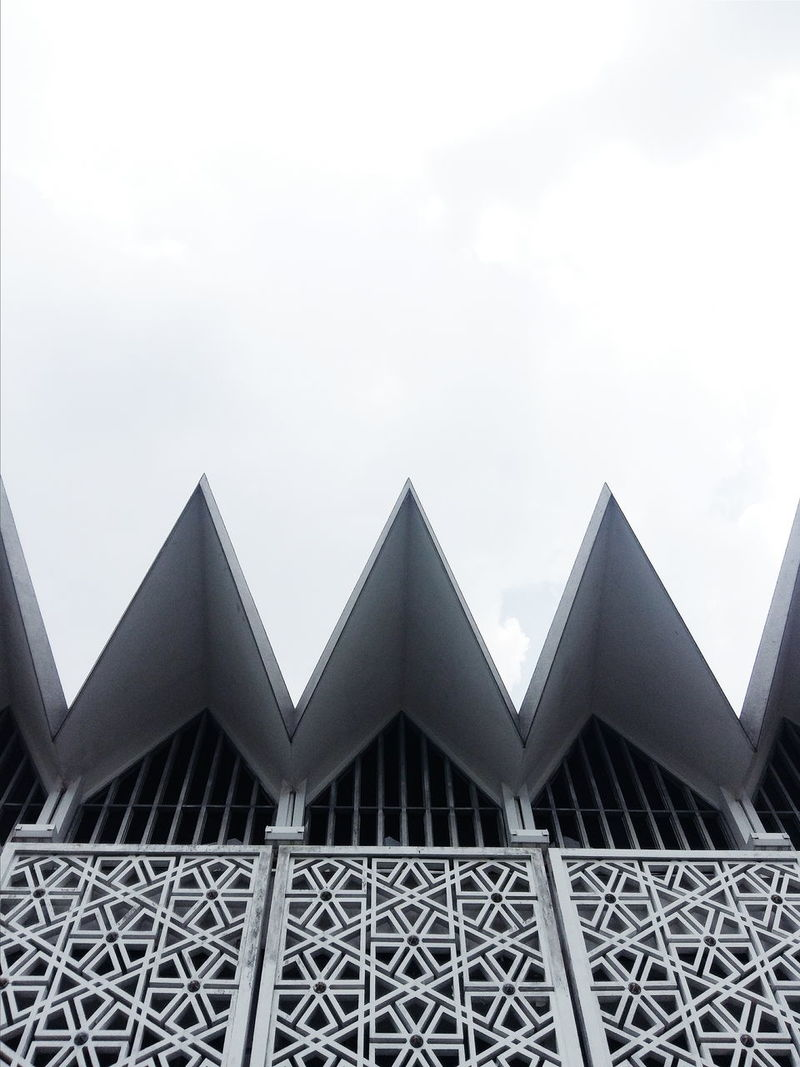 Architecture Triangle Shape Architecture Pattern Sky No People Building Exterior Outdoors Backgrounds Cloud - Sky Built Structure Aerospace Industry Day Metal EyeEmNewHere Streetphotography Steel City Building Edge Malaysia Travel Deconstruct Landscape Cityscape Sharp