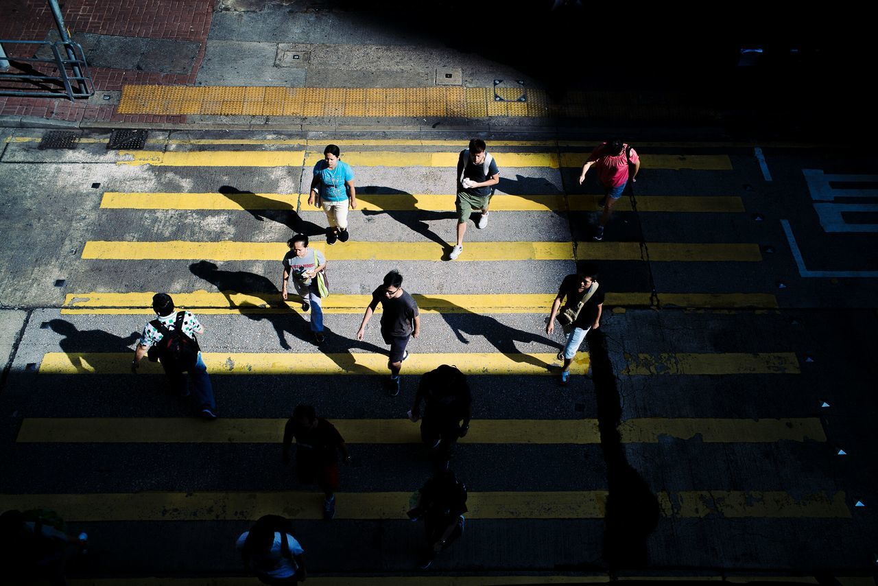 Shadow Sunlight High Angle View People Adults Only Lifestyles Silhouette Adult Men Togetherness Outdoors Real People Competition Only Men Large Group Of People Competitive Sport The City Light