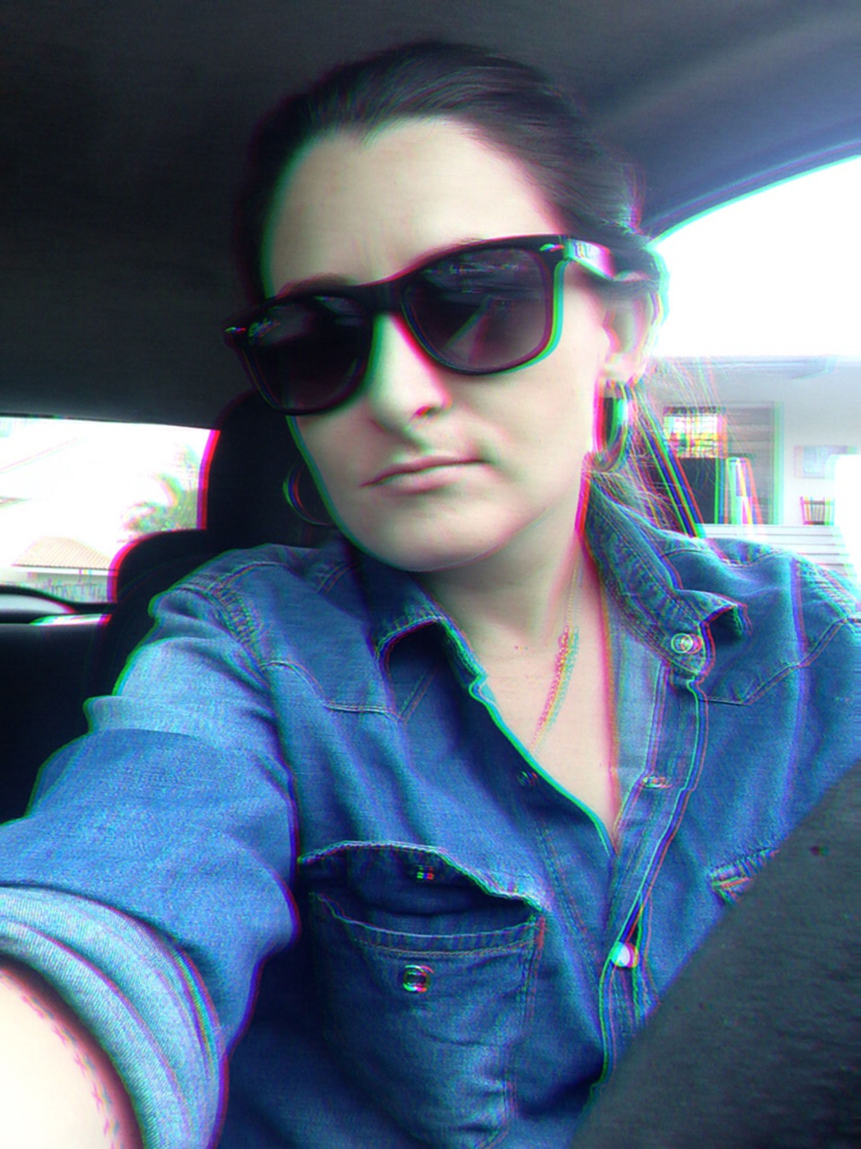 looking at camera, portrait, lifestyles, young adult, casual clothing, person, front view, leisure activity, sunglasses, indoors, transportation, headshot, mode of transport, car, eyeglasses, smiling, vehicle interior, land vehicle