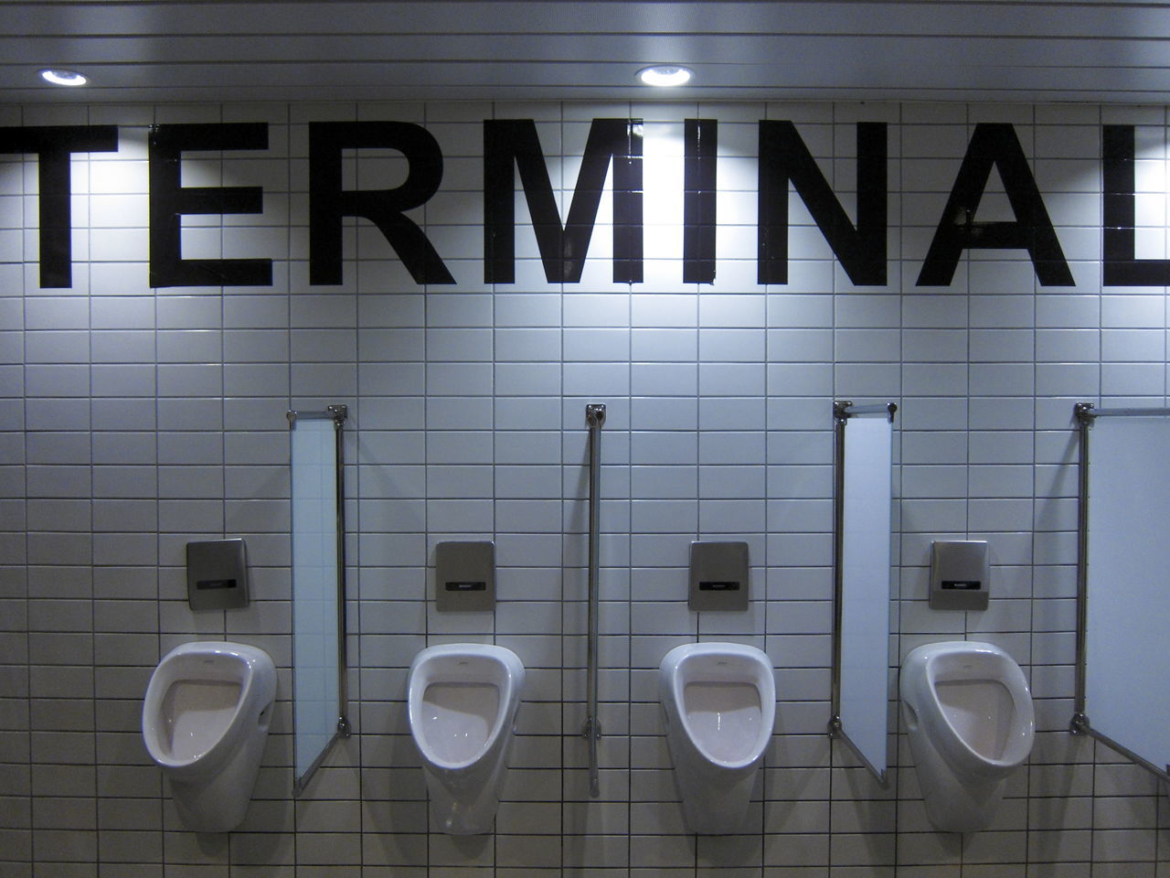 Bathroom Division Earthenware Glass Glass Division Glass Separation Hygiene Indoors  No People Separation Terminal Tile Tile Wall Tiled Floor Tiled Wall Tiles Toilets Urinal Urinals Wc White White Color White Tiles