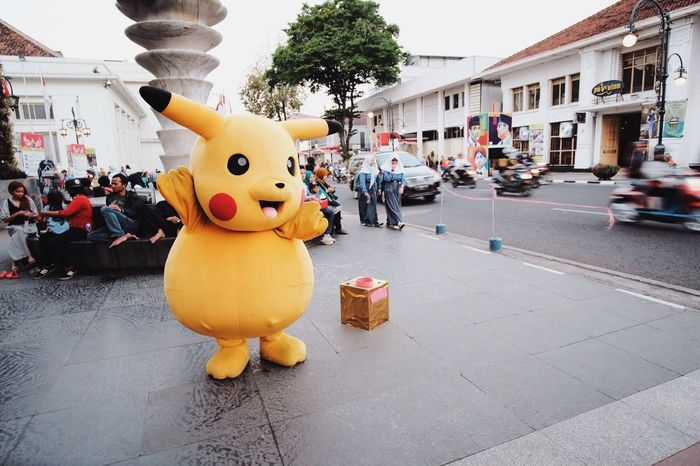 Gotta catch 'em all! Embrace Urban Life Streetphotography City Life Street Photography Street Performer EyeEm Gallery EyeEm Best Shots City Street Pokémon Fujifilm Travel Street Costume Paint The Town Yellow