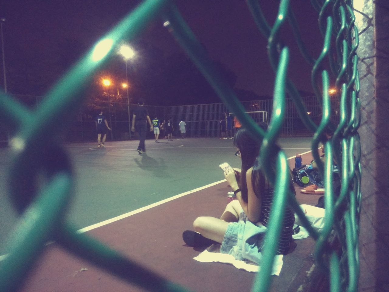 Focus On Foreground Futsal Futsal Team FutsalTime Girlfriend Illuminated Lady On The Phone Night Outdoors Waiting