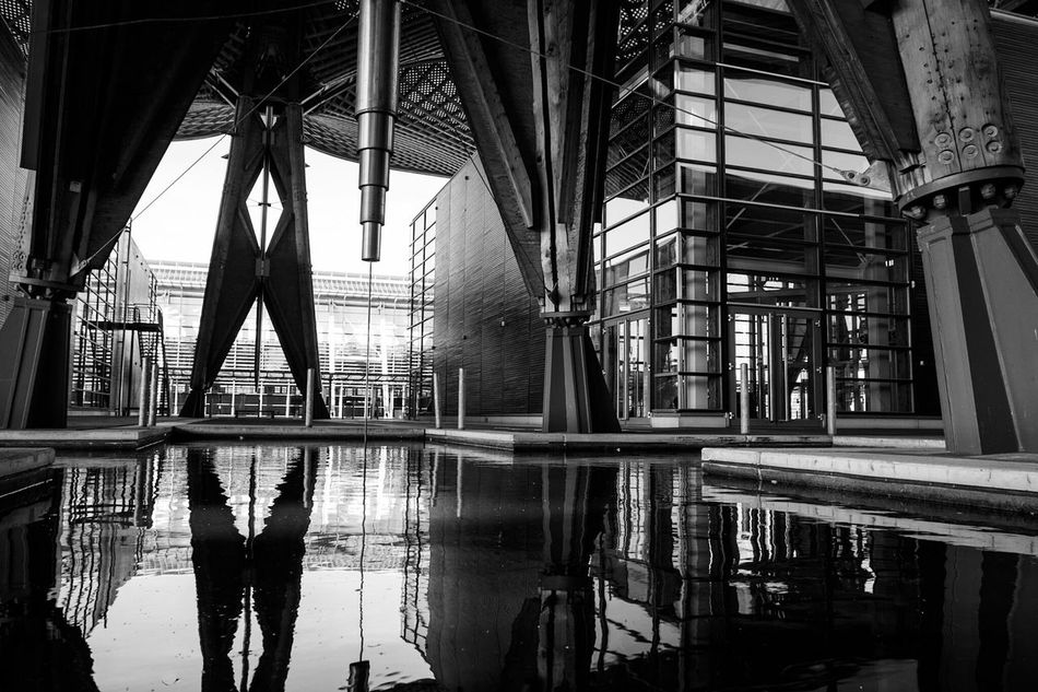 ~ ⛩✴~ Reflection Architecture Day Waterfront Monochrome Light And Shadow Black & White Lines And Shapes Getting Inspired Business Finance And Industry Connection Built Structure No People Water Reflections Architectural Feature Modern Architecture Black And White Streetphotography City Canonphotography EyeEm Best Shots Architectural Detail Metal Structure Geometric Shapes Welcome To Black