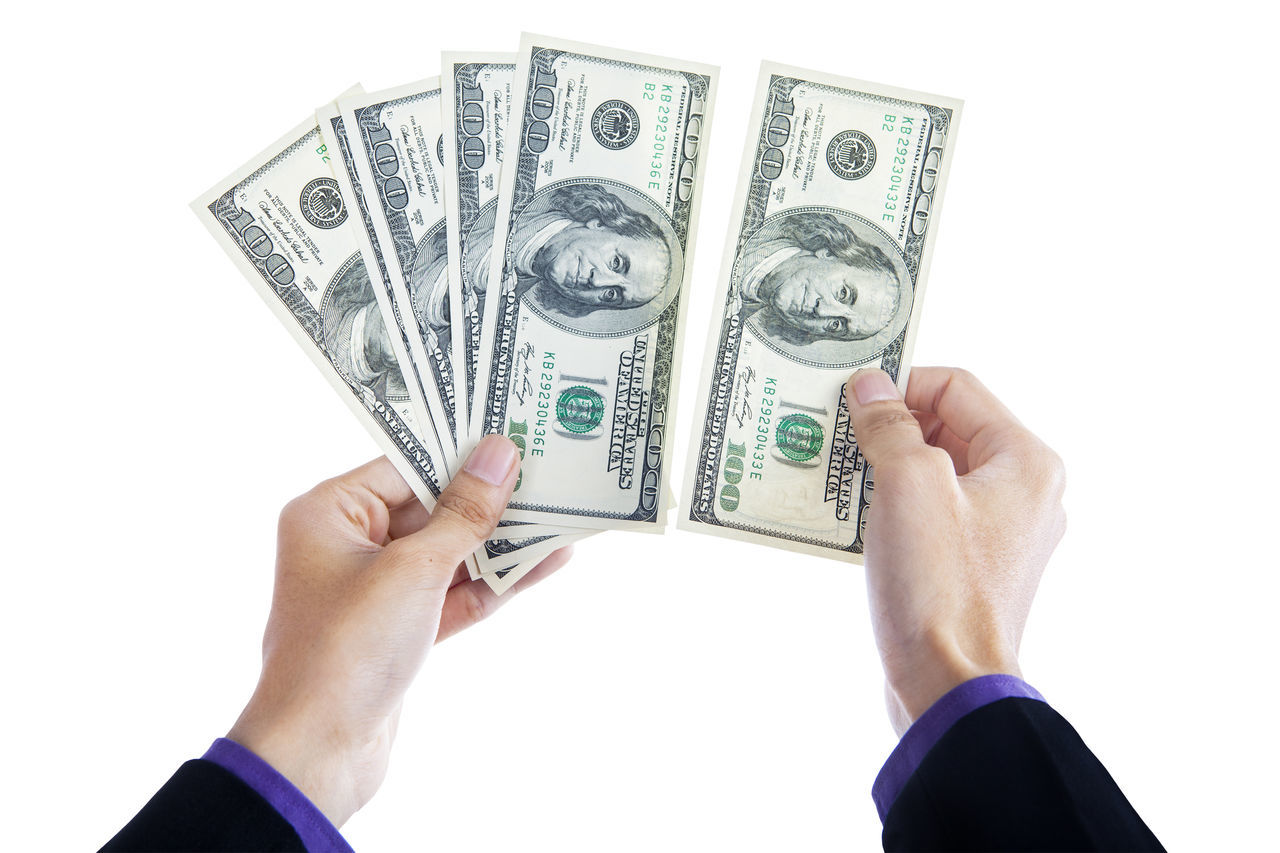Adult Bird Currency Fanned Out Finance Financial Item Holding Human Body Part Human Hand Investment Is Making Money Money, Dollar, One Person Paper Currency People Savings Studio Shot Wealth White Background