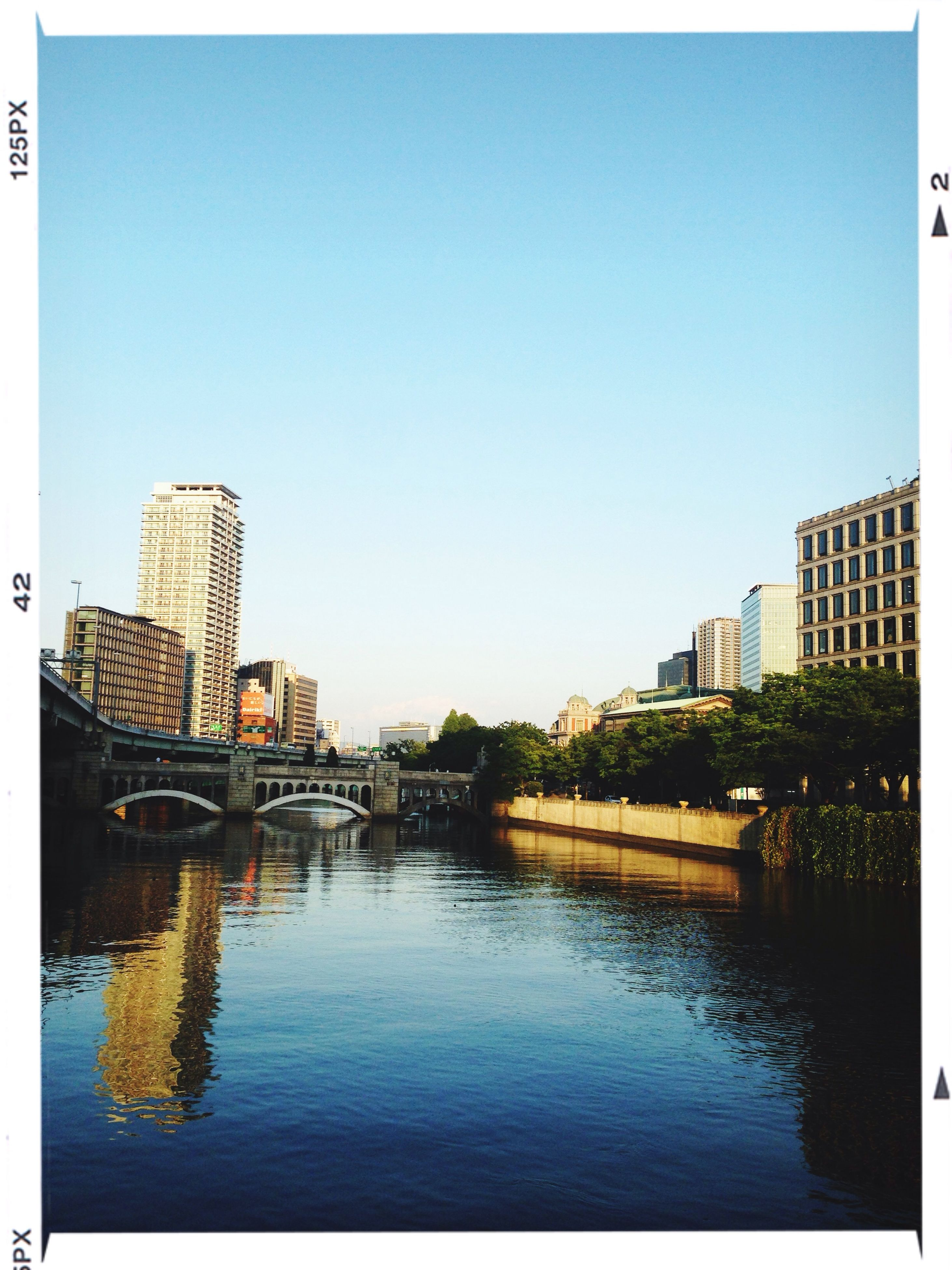 architecture, building exterior, built structure, clear sky, water, blue, transfer print, copy space, waterfront, reflection, river, auto post production filter, city, lake, day, outdoors, building, no people, residential building, residential structure