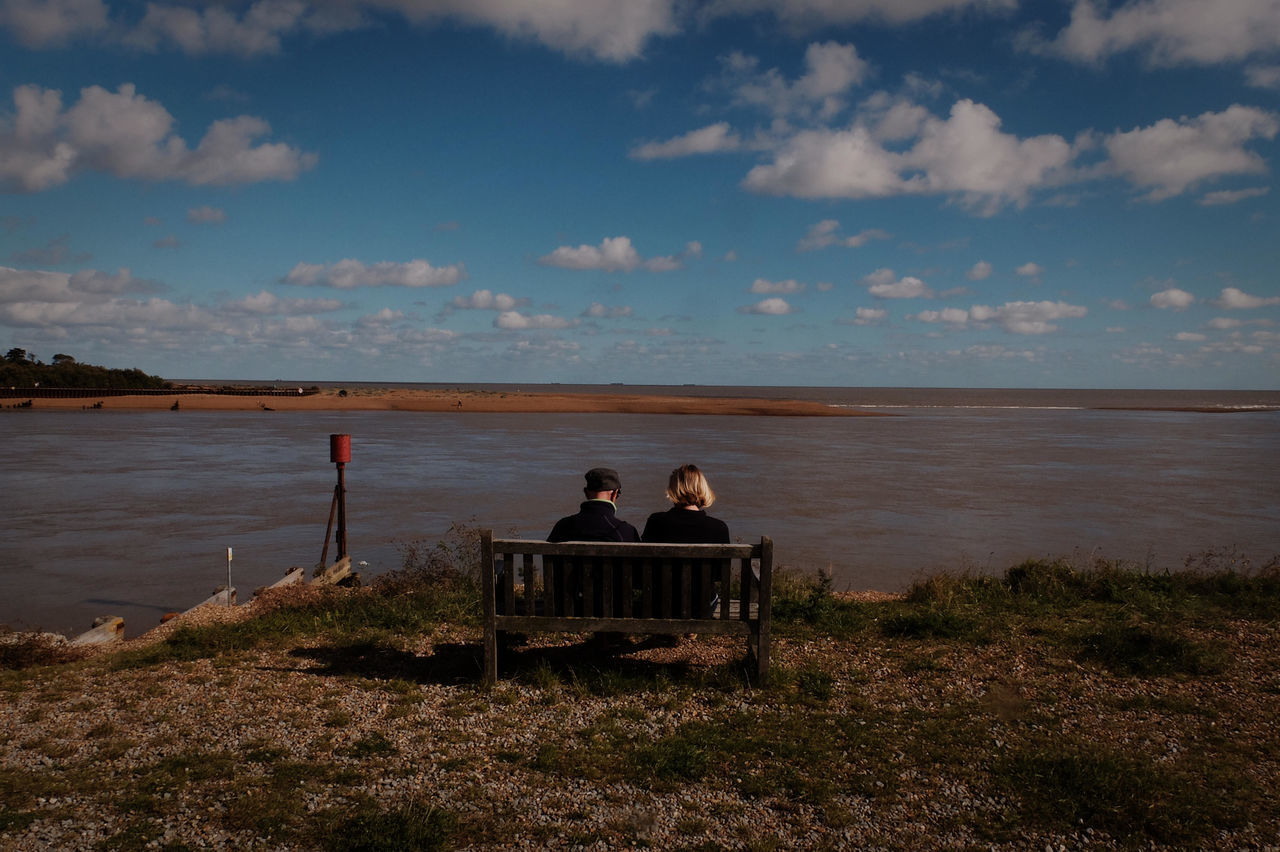 Couple Over Looking Beach Scape, Lowestof Beauty In Nature Big Blue Sky With Clouds Bonding Couple Overlooking Seascape Documentary Nature Photography Photography Taking Photos A Horizon Over Water Leisure Activity Lifestyles Men Nature Person Rear View Relaxation Reportage Street Photos Taking Fotos Images Photographic Camera Lens Architectural Design Building Structual Support Detail Of Tower Block In Sunshine Blue Sk Scenics Sea Sitting Sky Togetherness Tranquil Scene Tranquility Water