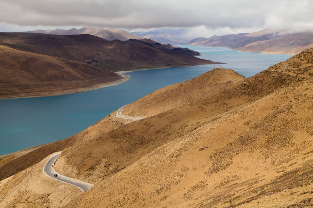 Spectacular landscape view of Yamdrok Lake, located at Tibet, China. Countryside Lake Lake View Landscape Mountain Mountain Range Road Roadtrip Tibet Wanderlust