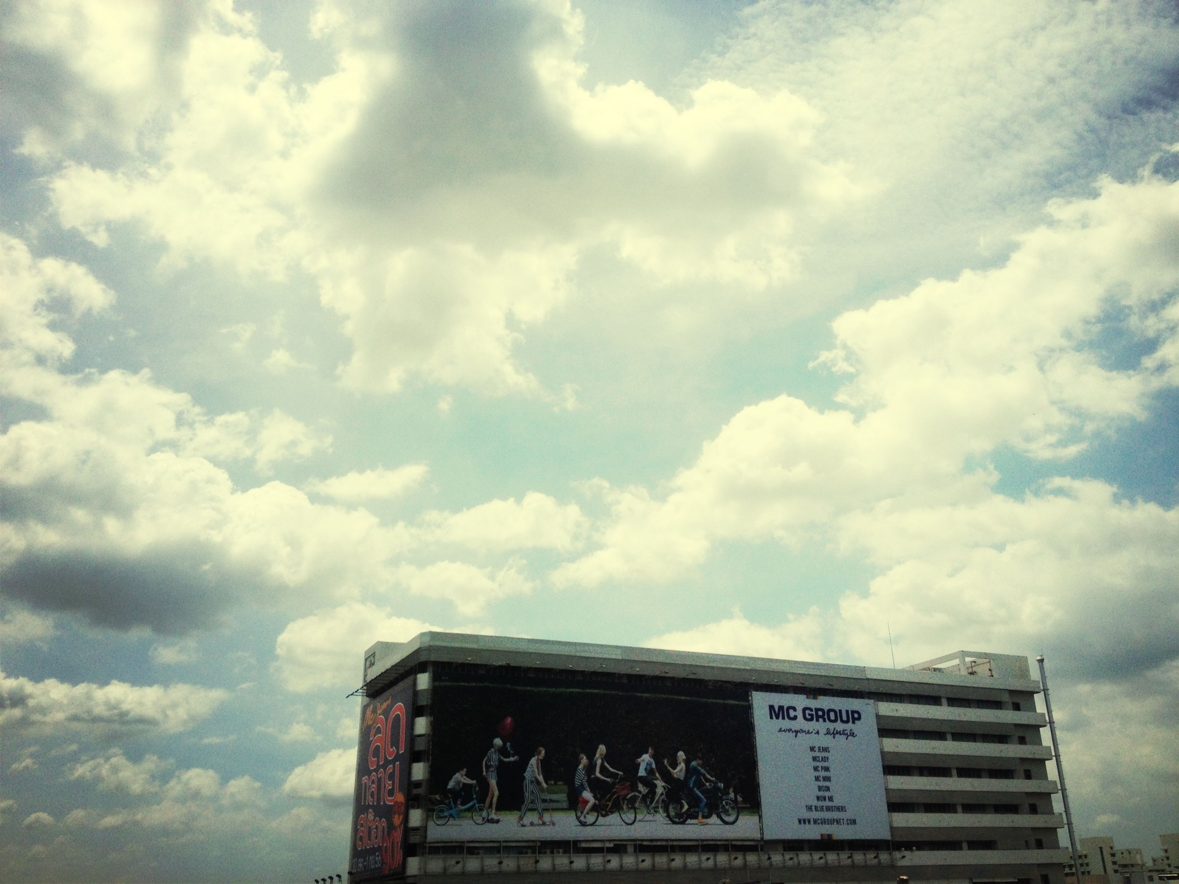 sky, text, cloud - sky, low angle view, western script, communication, cloudy, built structure, building exterior, architecture, cloud, day, capital letter, outdoors, information, no people, sign, non-western script, information sign, building