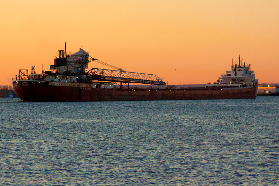 A large Great Lakes Frieghter Arriving on a Beautiful Fall Morning in Duluth Minnesota USA Philip R Clark Transportation Nautical Vessel Water Waterfront Beauty In Nature Outdoors Tranquil Scene Sky Tranquility Ship Journey Sunrise