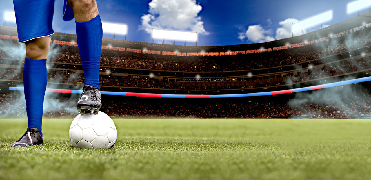 soccer, sport, soccer field, stadium, soccer player, human leg, soccer ball, sportsman, competition, ball, outdoors, one person, low section, professional sport, soccer uniform, men, motion, sports uniform, standing, playing, sports clothing, human body part, low angle view, competitive sport, athlete, sky, day, real people, soccer shoe, one man only, young adult, human hand, close-up, adult, people