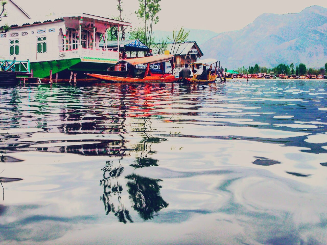 Boats In Dal Lake Against Mountains