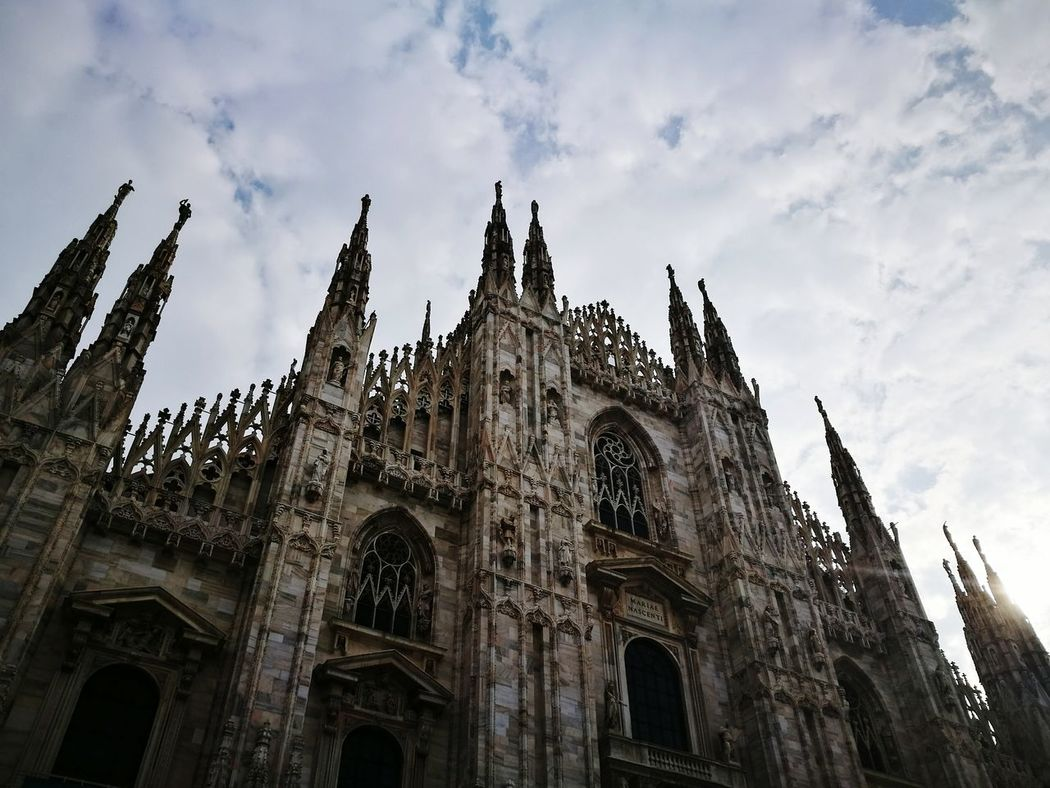 Architecture Travel Destinations Travel Built Structure History No People Place Of Worship City Sky Outdoors Cultures Day Milan Low Angle View City Architecture Arts Culture And Entertainment Piazza Duomo Milano Vertical Shot Fog City Cityscape Church Dome Cathedral