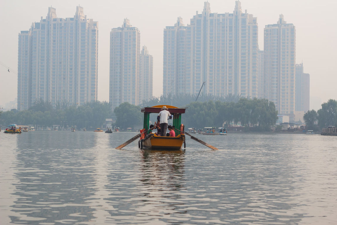 Architecture Beijing Boat Built Structure Capital Cities  Chaoyang Park China City City Life Cityscape Day Leisure Activity Lifestyles Modern Outdoors River Sky Skyscraper Tall - High Tourism Tower Travel Destinations Urban Skyline Water Waterfront