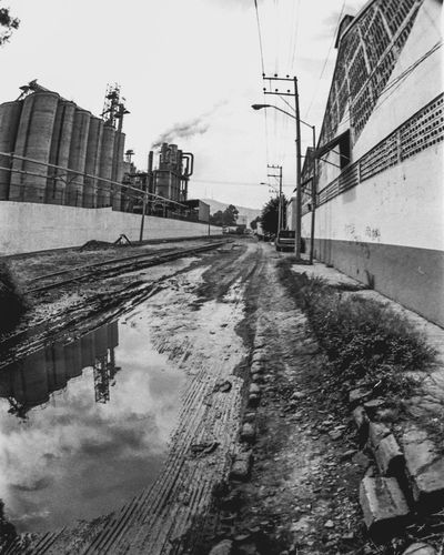Building Exterior Built Structure Architecture Transportation Sky Outdoors City Day Road The Way Forward No People Black And White Photography Monochrome Photography Damaged Old-fashioned Industrial Photography Industrial Landscapes Urban Lifestyle Old 35 Mm Camera 35mm Film Abandoned Low Angle View Urban Landscape Streetphotography Guadalajara