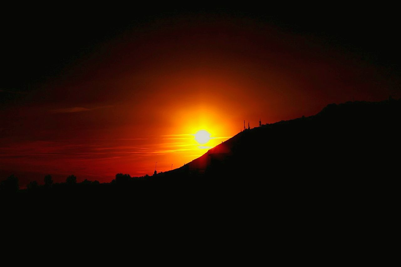 silhouette, sunset, orange color, sun, scenics, nature, beauty in nature, tranquil scene, tranquility, no people, sky, outdoors, landscape, day