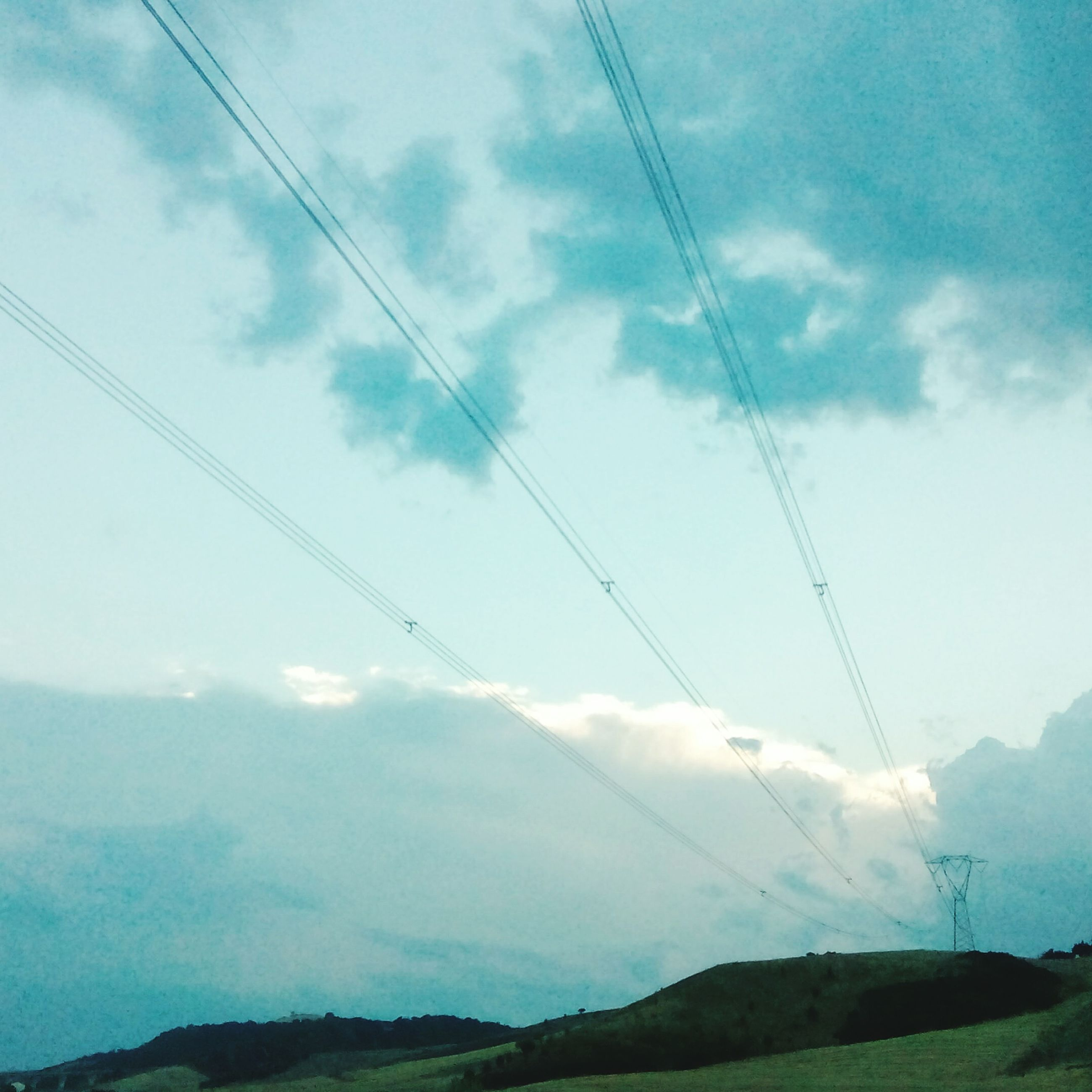 sky, mountain, power line, cable, electricity pylon, scenics, cloud - sky, tranquil scene, connection, electricity, tranquility, landscape, beauty in nature, mountain range, nature, power supply, cloud, cloudy, transportation, overhead cable car