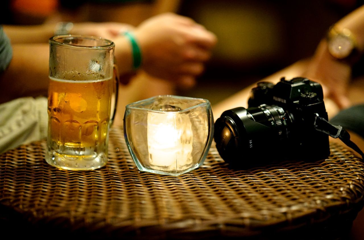 waiting for the perfect moment Adult Alcohol Backgrounds Beer - Alcohol Beer Glass Camera Can Close-up Drink Drinking Glass Food And Drink Freshness Human Hand Indoors  People Refreshment Table Table Bluff Table Setting