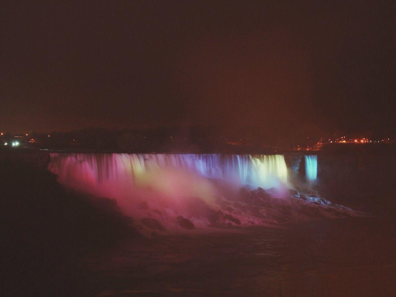 Illuminated Niagara Falls Against Sky At Night