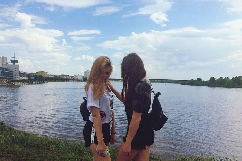 Long Hair Togetherness Young Adult Only Young Women Young Women Friendship Cloud - Sky Walking Leisure Activity Sky Carefree Vacations Adult Two People Day People Standing Summer Bonding Happiness