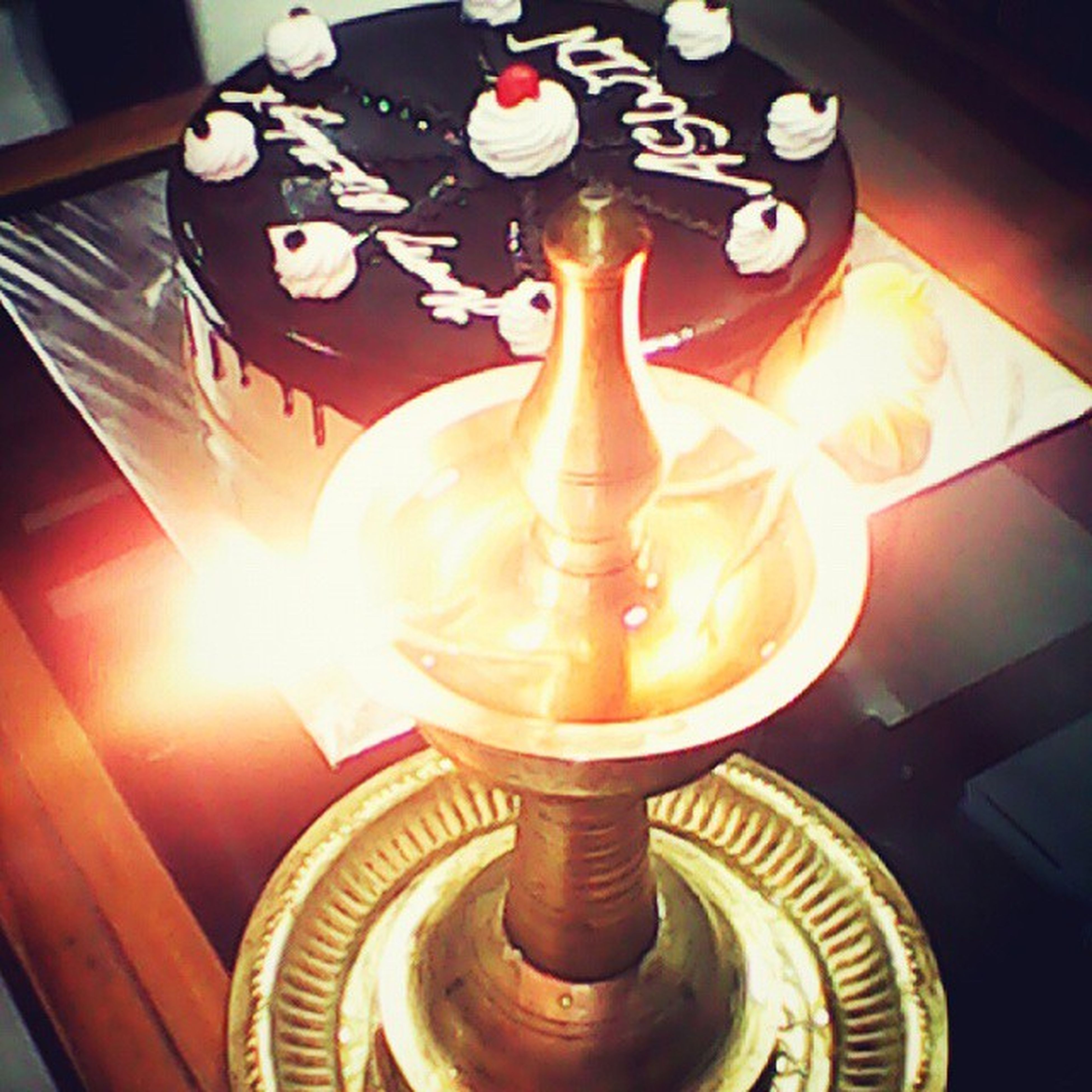 indoors, still life, table, high angle view, illuminated, close-up, no people, decoration, candle, lighting equipment, technology, home interior, wood - material, shiny, pattern, heat - temperature, old-fashioned, spiral, glowing, glass - material