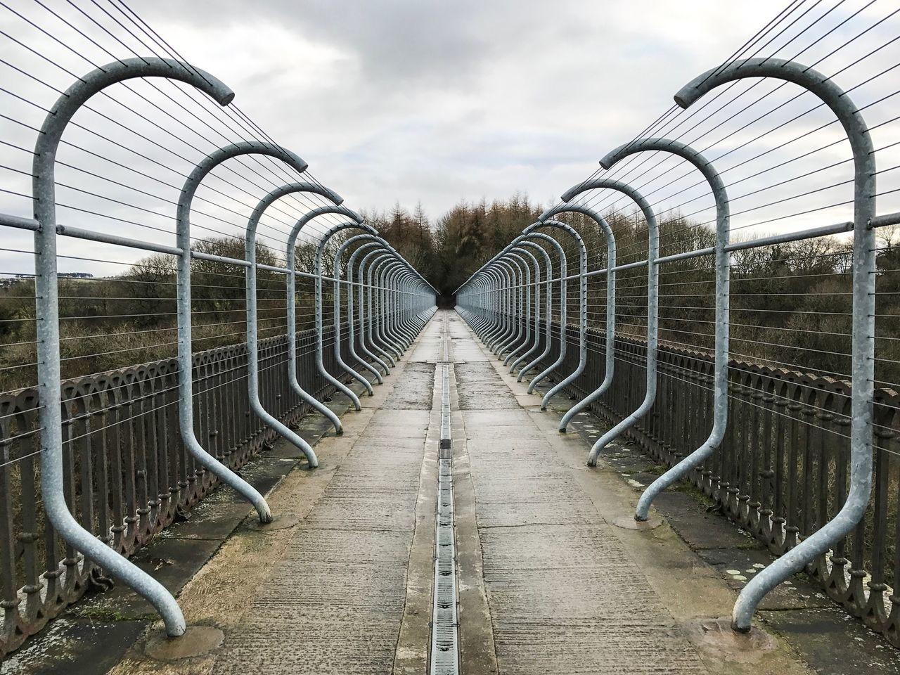 metal, the way forward, in a row, sky, day, railing, outdoors, no people, bicycle rack, architecture