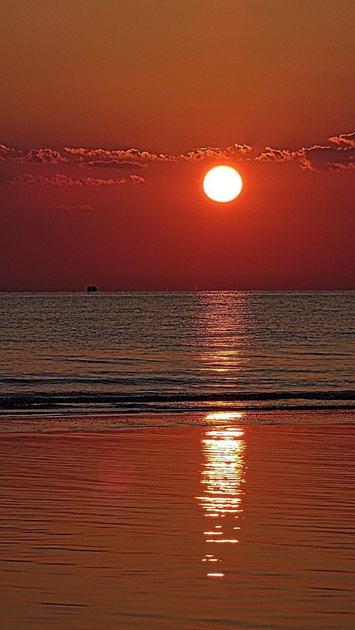 sunset, scenics, sea, beauty in nature, sun, water, orange color, reflection, nature, tranquil scene, tranquility, idyllic, horizon over water, sky, beach, outdoors, waterfront, no people, sunlight, travel destinations