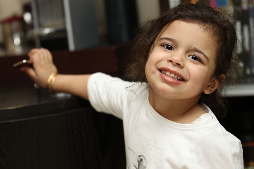 Looking At Camera Smiling Childhood Girls Indoors  Happiness Cute Shy Posing Portrait Looking Playing