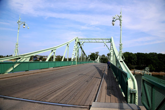 One of Gustave Eiffel's students has constructed this bridge in Liepaja Bridge Cable Connection Liepaja Karosta Diminishing Perspective Engineering Green Gustave Eiffel Street Light Swing Bridge Swing Bridge In Karosta Swivel Bridge Travel Destinations Vanishing Point