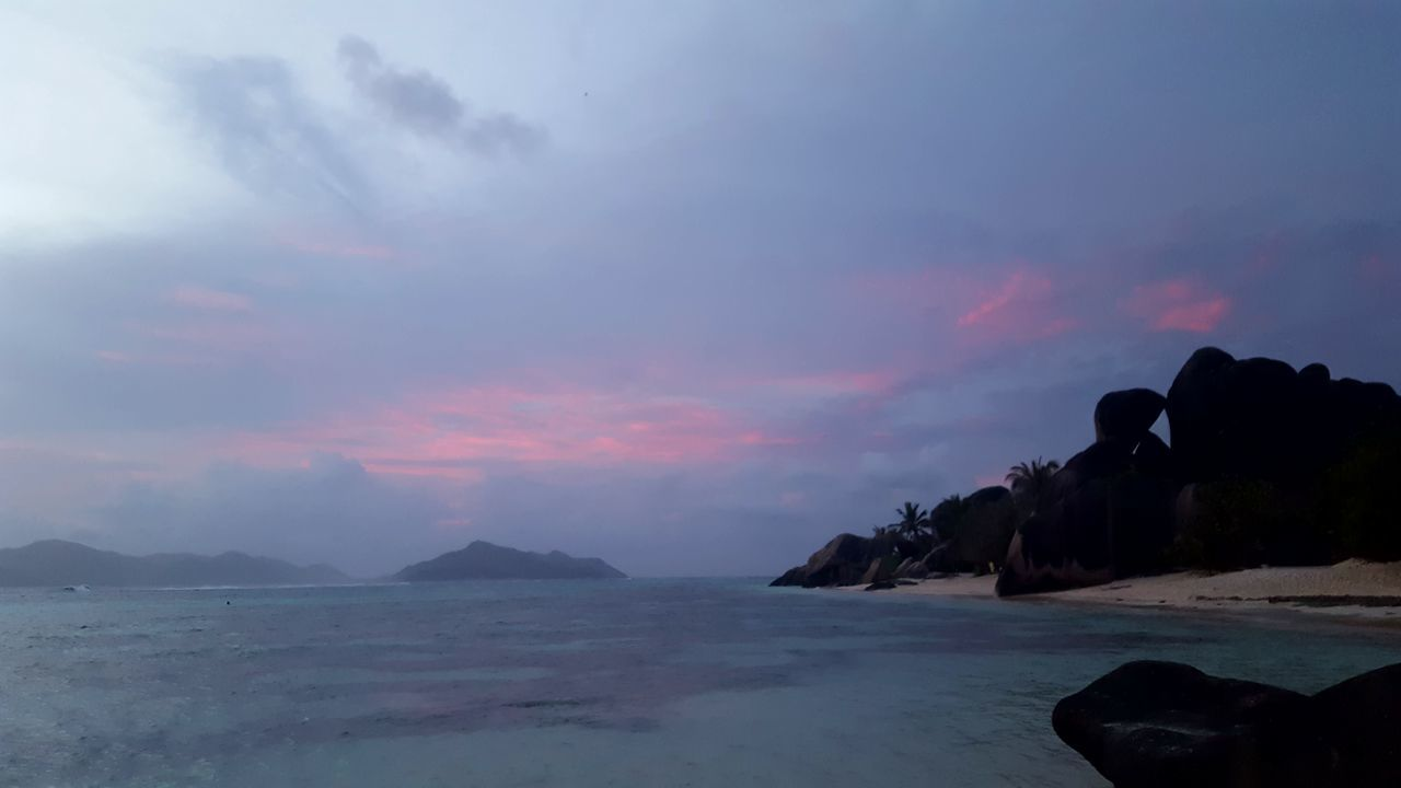 Sea Landscape Outdoors No People Sunset Nature Water Sky Beauty In Nature Summer Dramatic Sky Seychelles Sunset Tropical Paradise La Digue Seychellesisland Horizon Over Water Anse Source D'argent Beach Beauty In Nature Seychelles