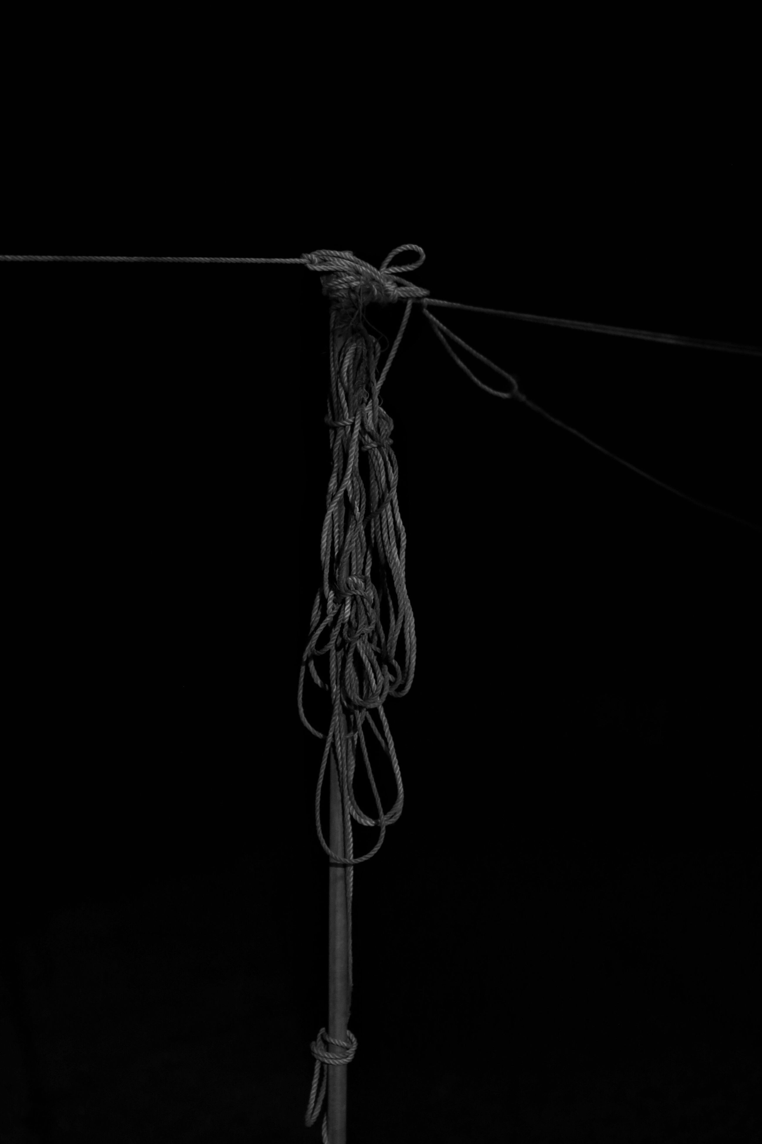copy space, black background, studio shot, night, close-up, art and craft, creativity, art, no people, low angle view, rope, dark, electricity, clear sky, outdoors, metal, pole, single object, hanging, still life