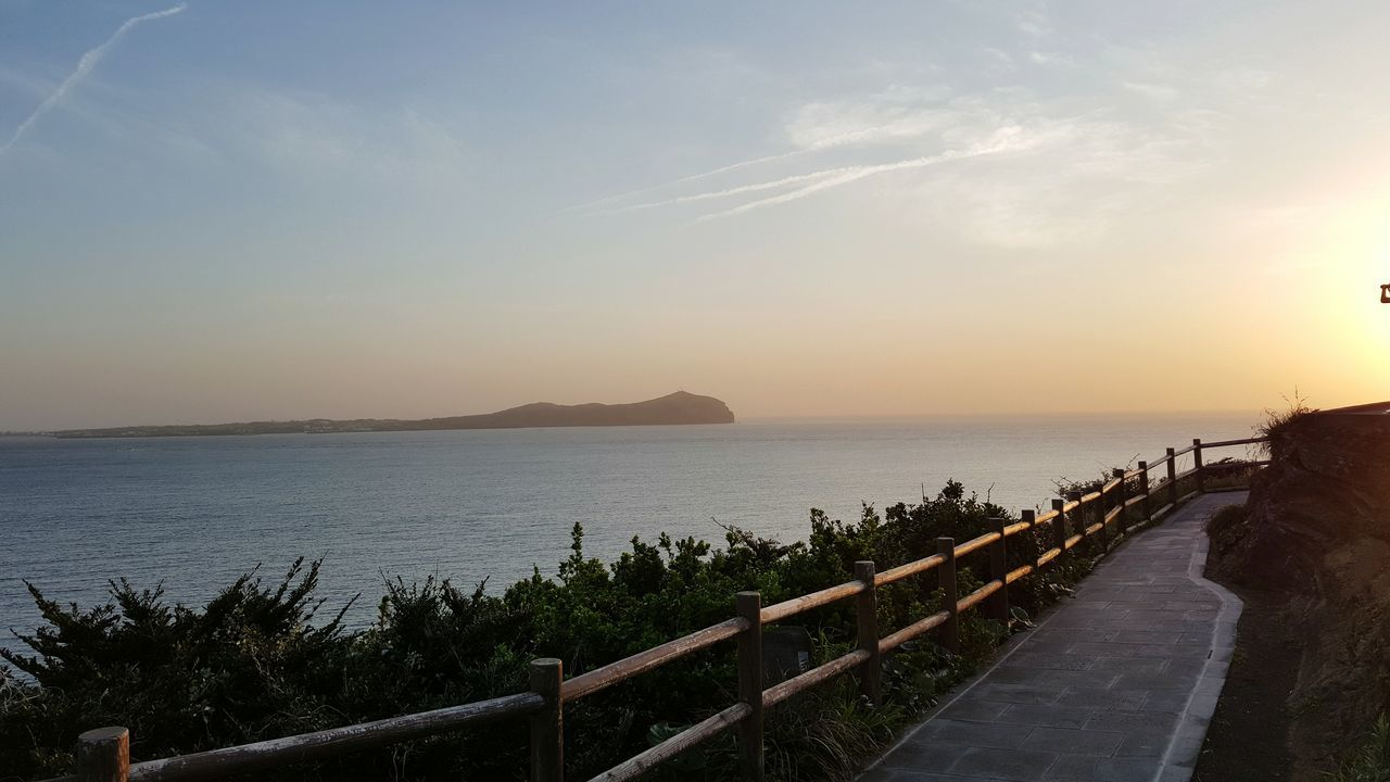 Fence Road Roadtrip Udo Sea Travel Destinations Tourism Landscape Scenics Beauty In Nature Water Outdoors Cloud - Sky Sky Horizon Over Water No People Sunrise Reflection