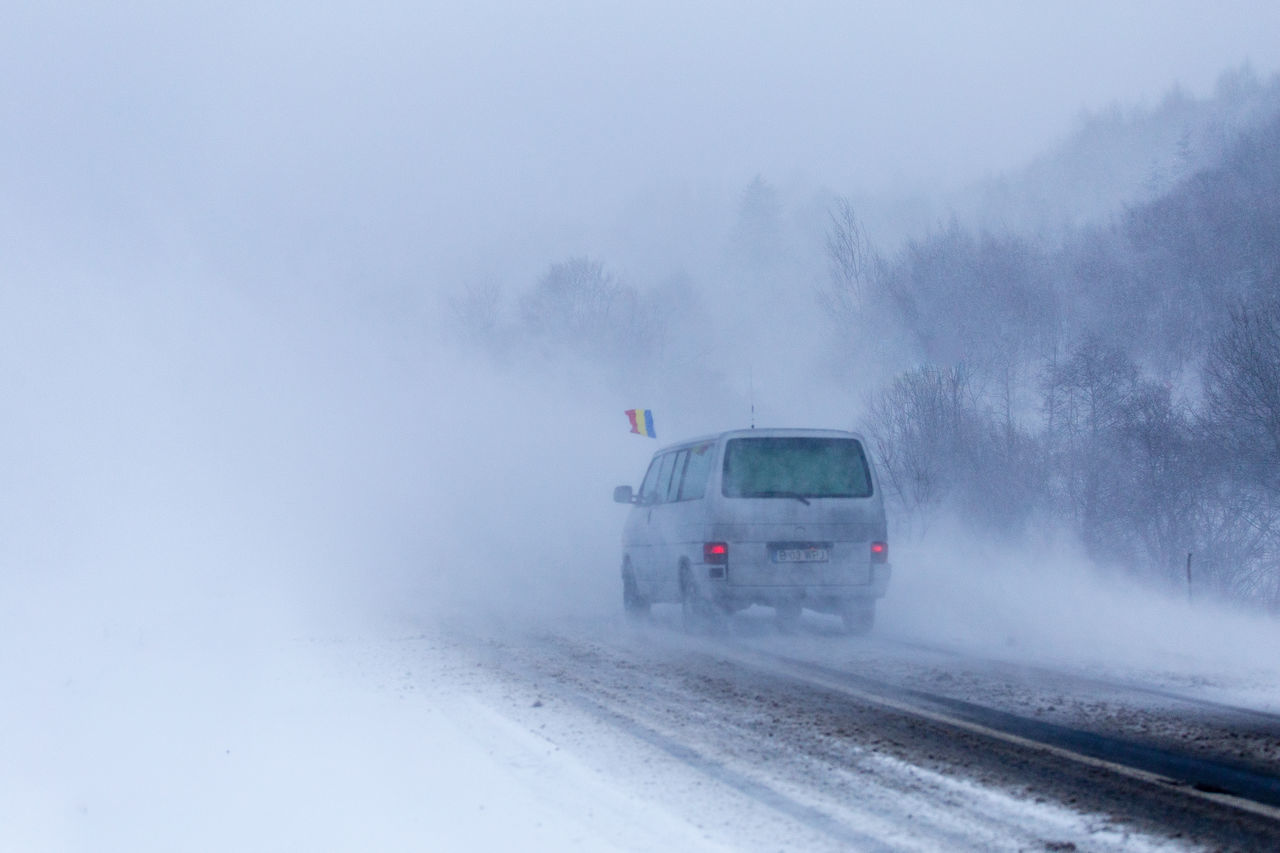 Beauty In Nature BYOPaper! Car Cold Temperature Day Fog Foggy Land Vehicle Mode Of Transport Nature No People Outdoors Sky Smoke - Physical Structure Snow Snowing Transportation Travel Weather Winter