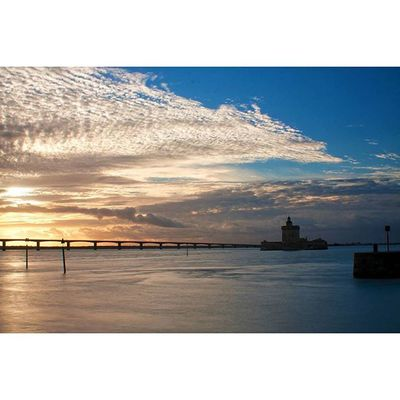 Lechateau with a Bridge Bayofbiscay at sunset in autumn 35mm dslrcanon skylovers cloud paintingwiththesun screaming_shots naturelovers naturalwonder silhouette rsa_nature longexposure sky_sultans France Edge Of The World