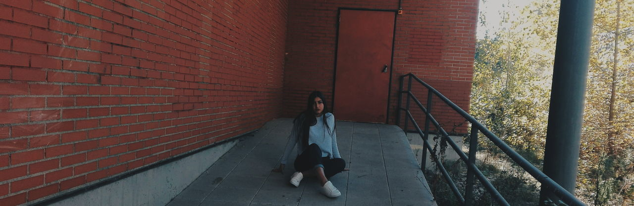 Brick Wall Full Length One Person Architecture Real People Built Structure Lifestyles Outdoors Building Exterior Day People Adults Only Adult PlazaCastilla Lighting Equipment Torres De Madrid Demadridalcielo MetroMadrid Castellana Madriz Like4like Followme Follow Indoors  Madrid