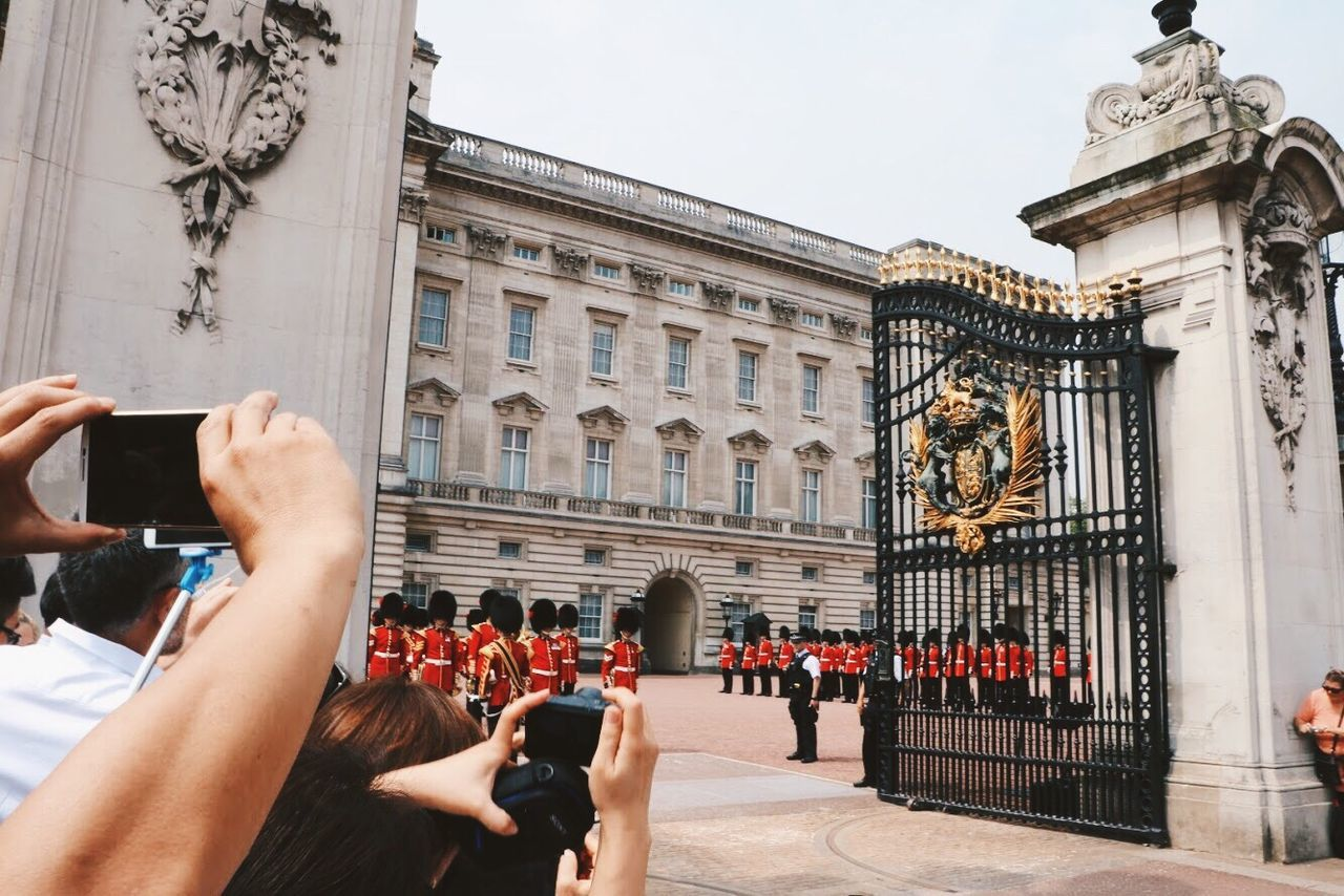 The queen's birthday wireless technology Mobile phone smart phone portable information device photographing communication photography themes photo messaging Architecture technology selfie using phone large group of people building exterior people telephone real people built structure outdoors women travel destinations tourism Travel EyeEm LOST iN London Postcode Postcards