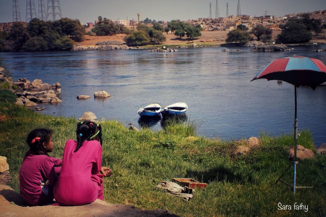 Real People Water Outdoors Nature Leisure Activity Day People Natural Beauty Lake Mirror Of Life Photo Is Happiness Moments Summer 2016 Life Is Simple Kids Camera View Nile River Thinking Of The Life Aswan Looking For Beauty River City Of Peace Photo Is Everything