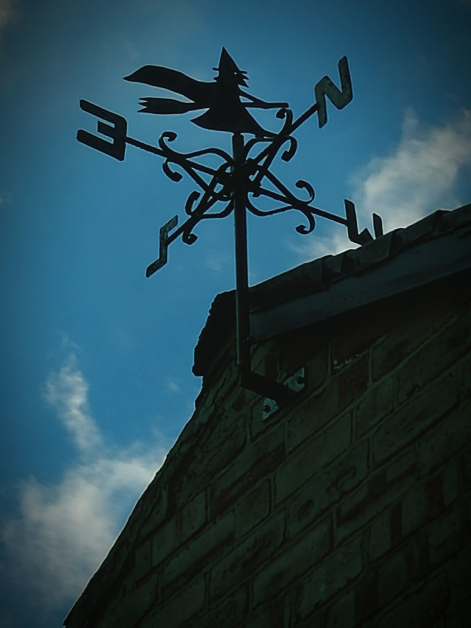low angle view, architecture, building exterior, built structure, sky, outdoors, direction, guidance, cloud - sky, no people, day, weather vane