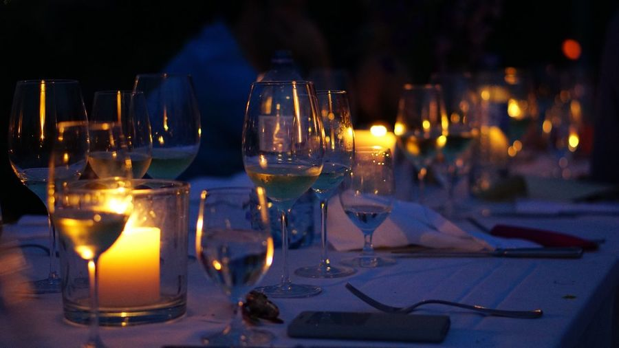 Table Wineglass Candle Flame Night Wine Burning Celebration Illuminated Place Setting Food And Drink No People Indoors  Drinking Glass Close-up