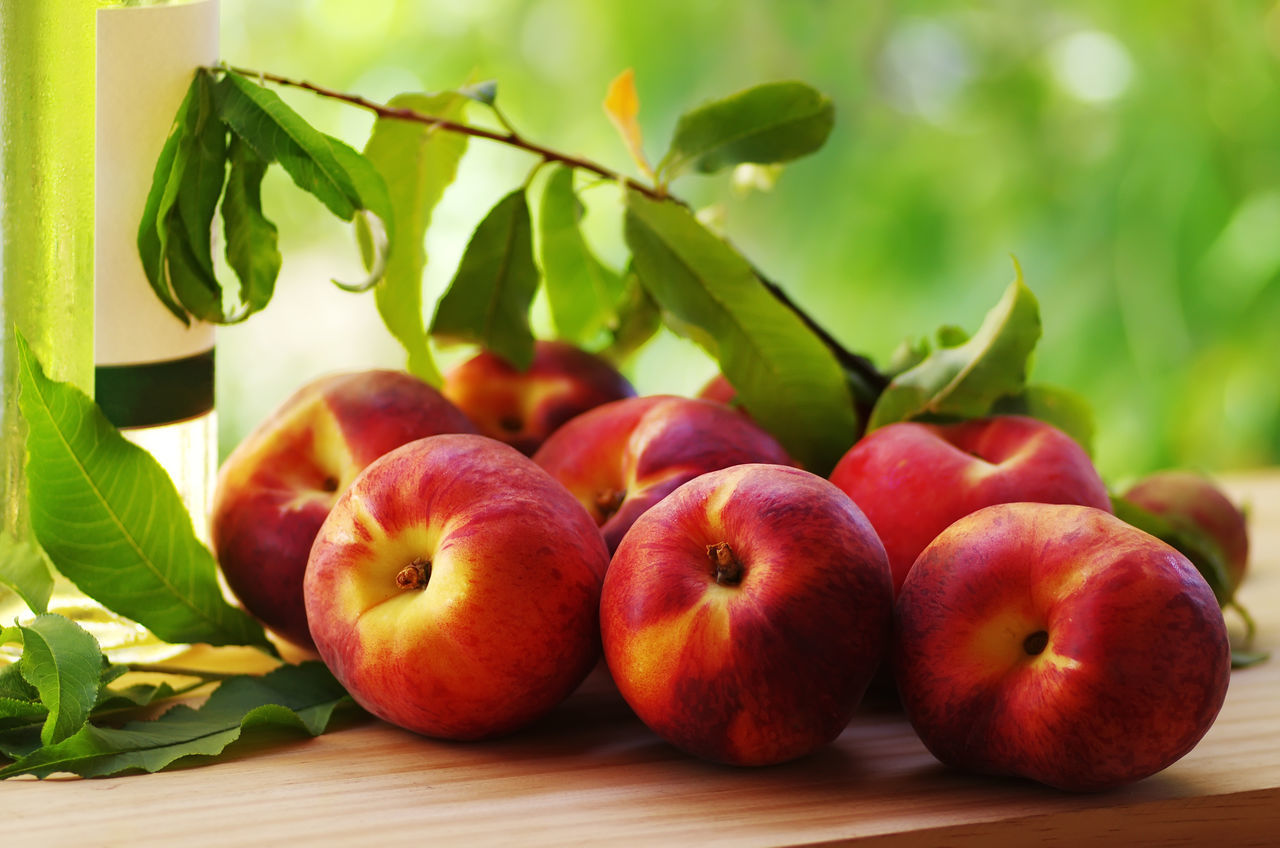fruit, food and drink, healthy eating, food, freshness, apple - fruit, leaf, green color, red, table, no people, close-up, indoors, growth, day, nature