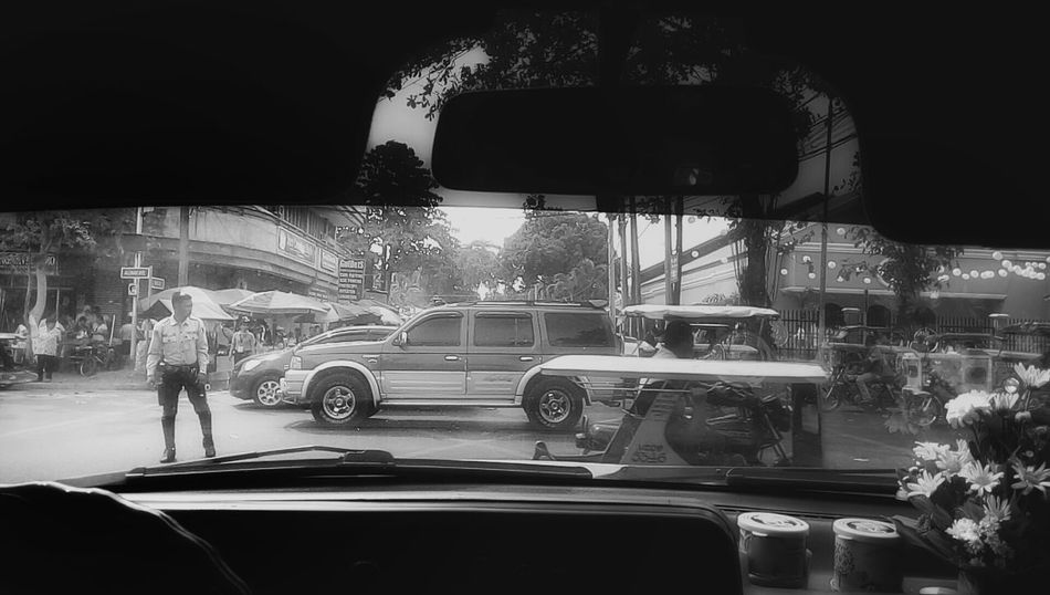 Here Belongs To Me Traffic Enforcer Streetphotography Streetphoto_bw Blackandwhite Blackandwhite Photography Vehicles In The Car March Showcase Photooftheday Peoplephotography Crossroads
