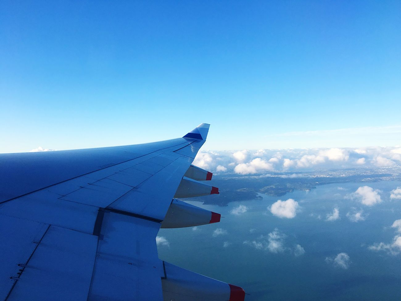 Airplane Transportation Flying Travel Sky Blue Journey Aircraft Wing No People Airplane Wing Mode Of Transport Nature Air Vehicle Cloud - Sky Day Outdoors Beauty In Nature